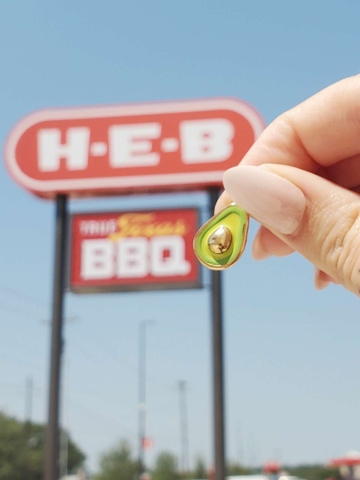 It's an avocado... charm. These are just one of the many charms you can get at the H-E-B locations.