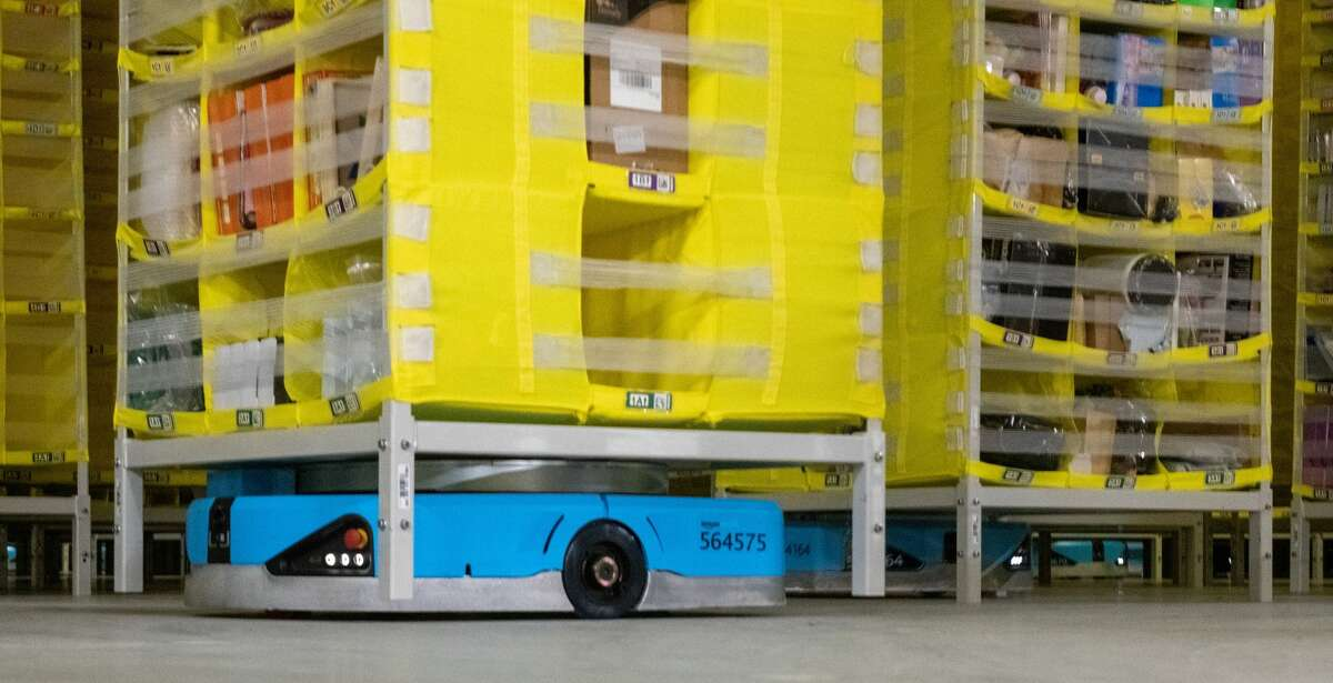A logistics robot moves pallets through a warehouse at Amazon.(Photo by Stefan Puchner/picture alliance via Getty Images)