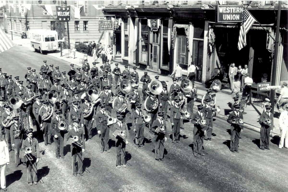 The office for the Western Union Telegraph Company was formerly located at 420 River St. can be seen on the far right of the photograph taken during the band parade of the 1940 Manistee National Forest Festival. (Manistee County Historical Museum photo)