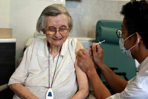 An elderly patient receives the 3rd dose of the Pfizer-BioNtech Covid-19 vaccine in Paris, on September 13, 2021. (Photo by THOMAS COEX / AFP via Getty Images)