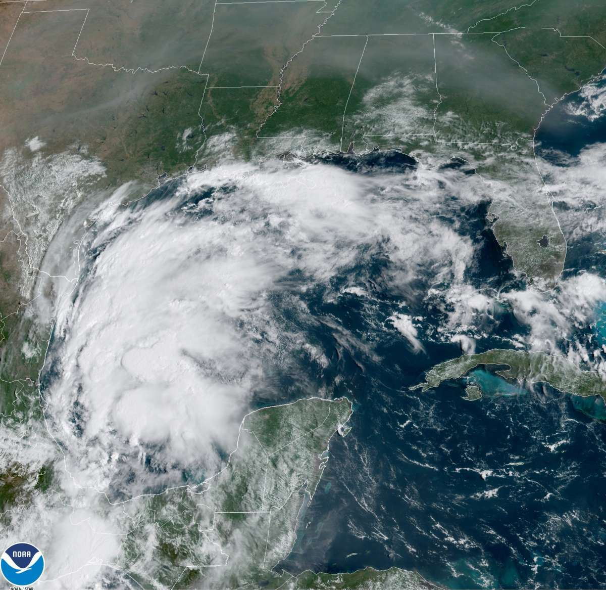 This satellite image provided by NOAA shows Tropical Storm Nicholas in the Gulf of Mexico on Sunday, Sept. 12, 2021. Tropical storm warnings have been issued for coastal Texas and the northeast coast of Mexico. Nicholas is expected to produce storm total rainfall of 5 to 10 inches, with isolated maximum amounts of 15 inches, across portions of coastal Texas into southwest Louisiana Sunday, Sept. 12 through midweek. (NOAA via AP)AP