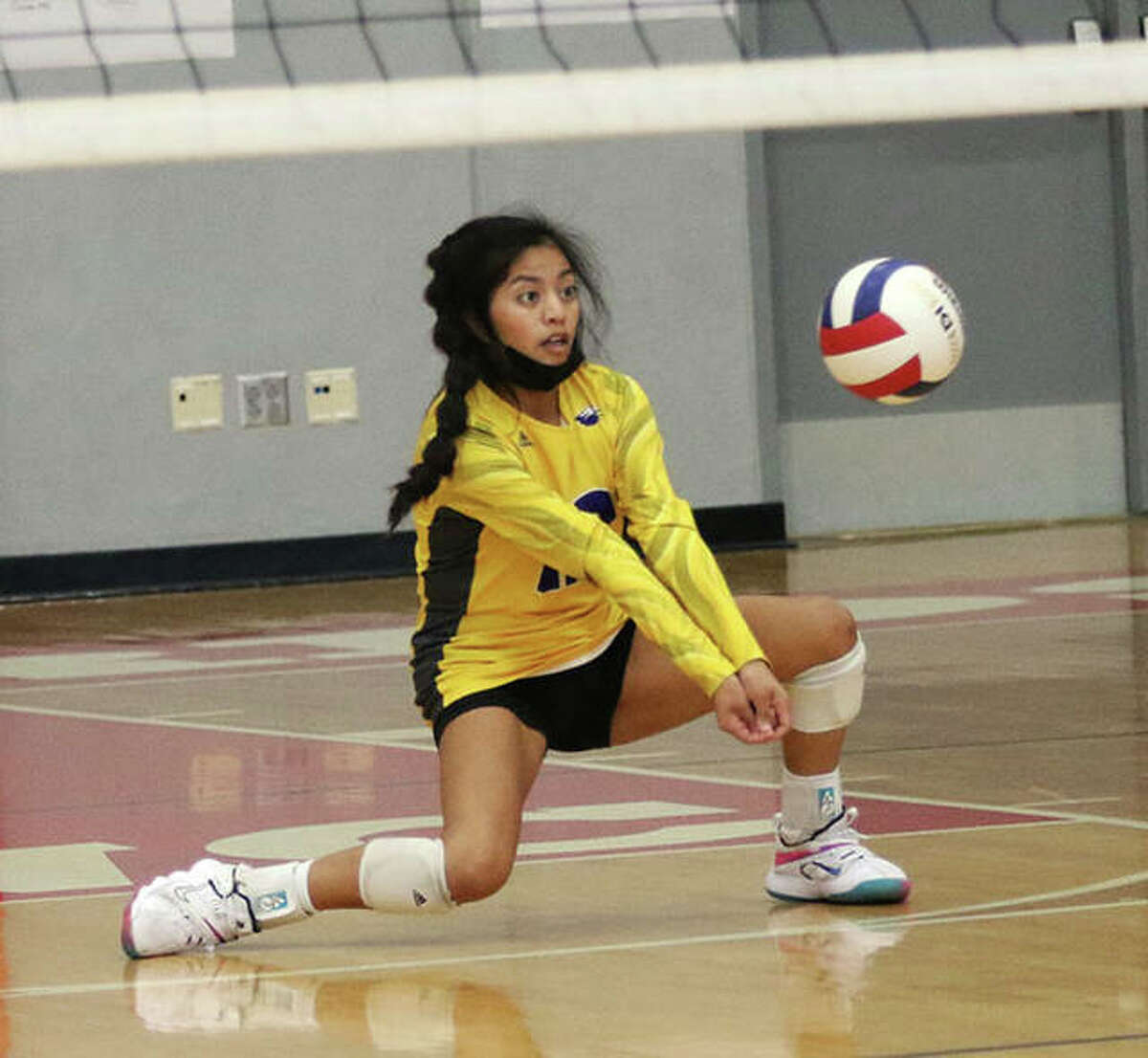 CM senior libero Ella Middleton receives a serve from Triad in the championship match of the Alton Invitational girls volleyball tournament Saturday at Alton High in Godfrey.