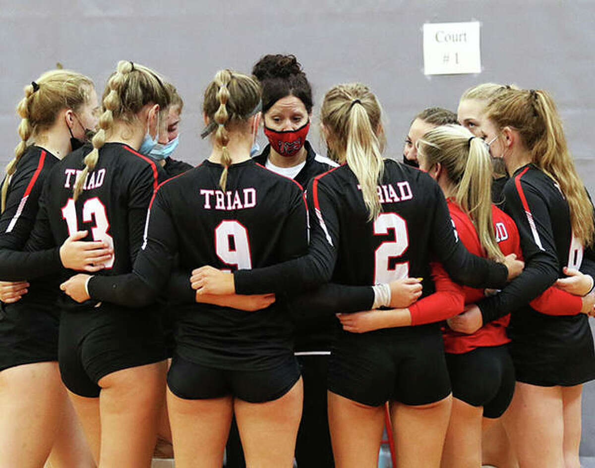 The Triad Knights huddle around coach Jami Parker before their team's victory over CM in the title match of the Alton Tourney on Saturday at Alton High in Godfrey.