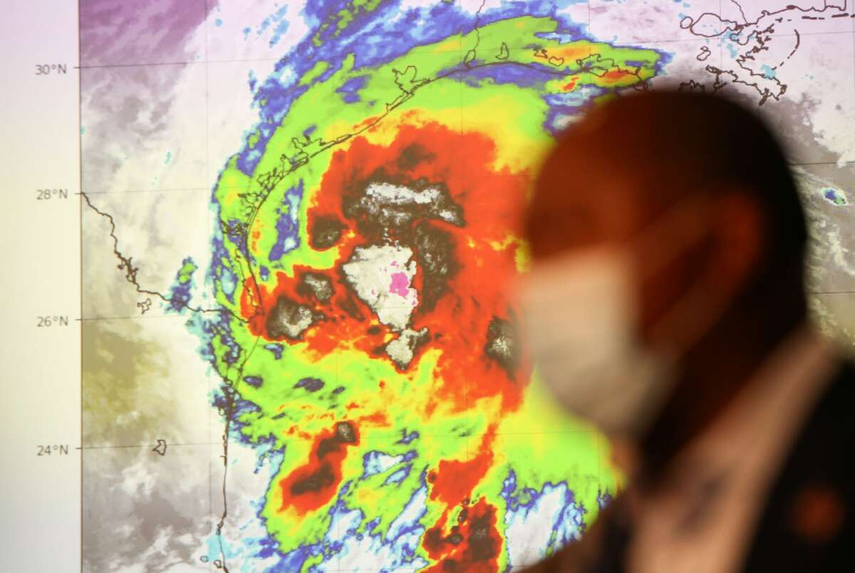 A screen shows Tropical Storm Nicholas as it heads towards the Texas coast, while Houston Mayor Sylvester Turner speaks with reporters, Monday, Sept. 13, 2021, at the city's emergency operations center in Houston.