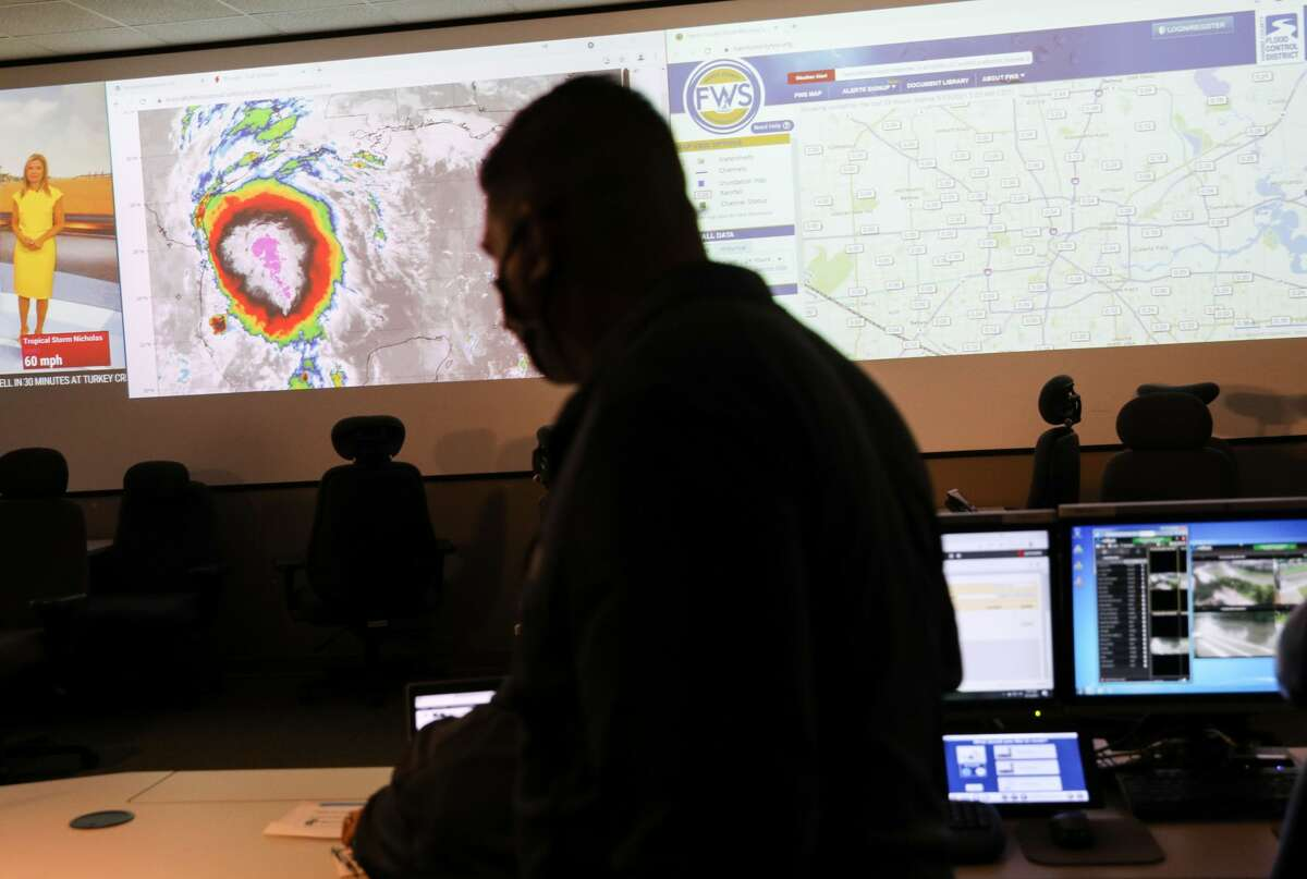 A screen shows Tropical Storm Nicholas as it heads towards the Texas coast Monday, Sept. 13, 2021, at the city's emergency operations center in Houston.