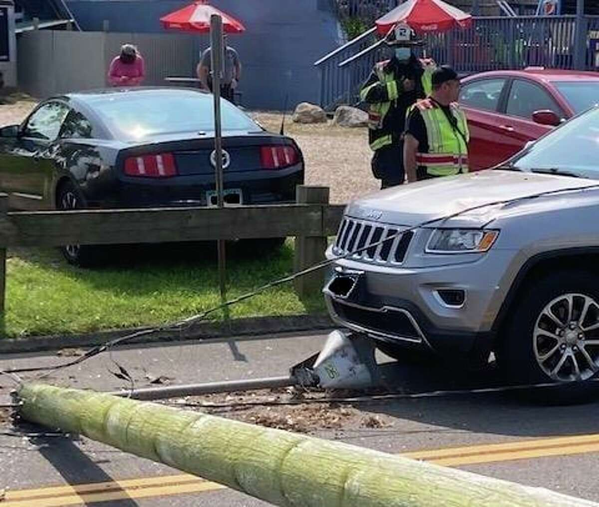Shortly after 1 p.m. Sunday, Sept. 12, 2021, fire units responded to a report of a utility pole with wires down on a vehicle with a person inside the vehicle at Ferry Park, near the access road to the ferry, in Rocky Hill, Conn., fire officials said. Edits to the license plates on vehicles in this photo were not made by Hearst Connecticut Media.