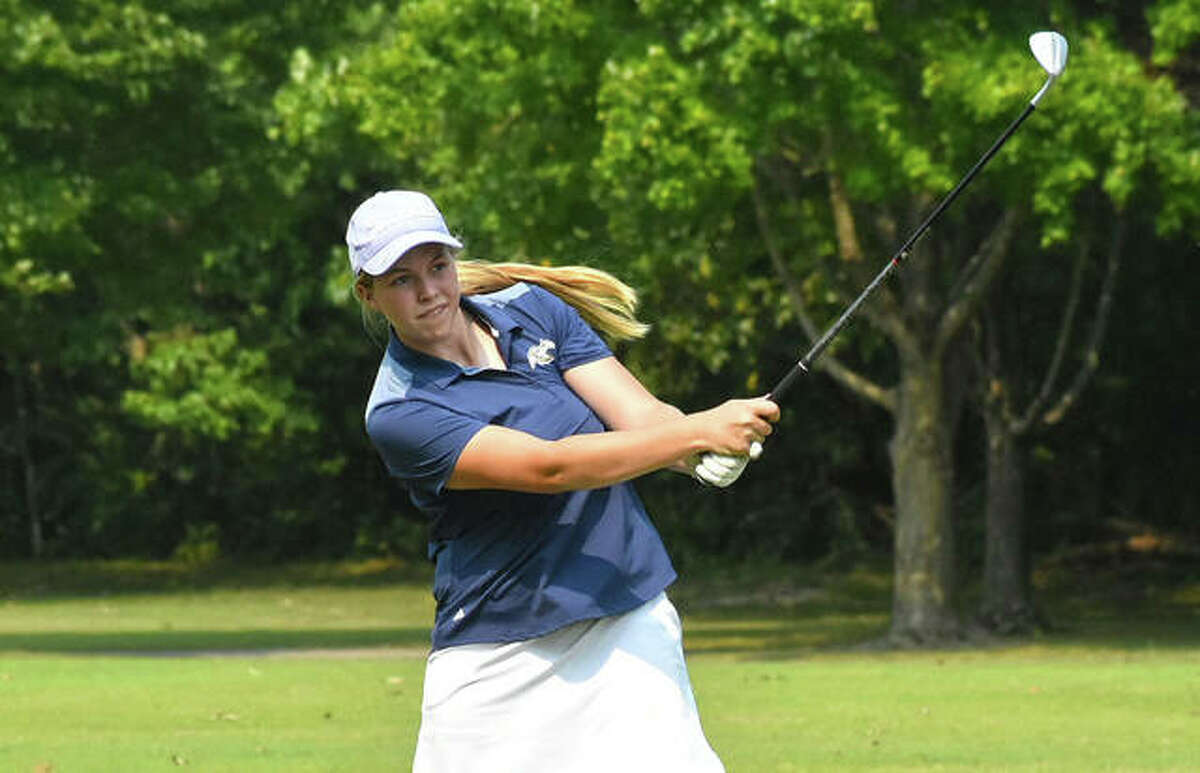 Father McGivney's Julia Stobie follows through on her third shot on hole No. 3 at Rolling Hills Golf Course during the Alton Invitational on Saturday in Godfrey.
