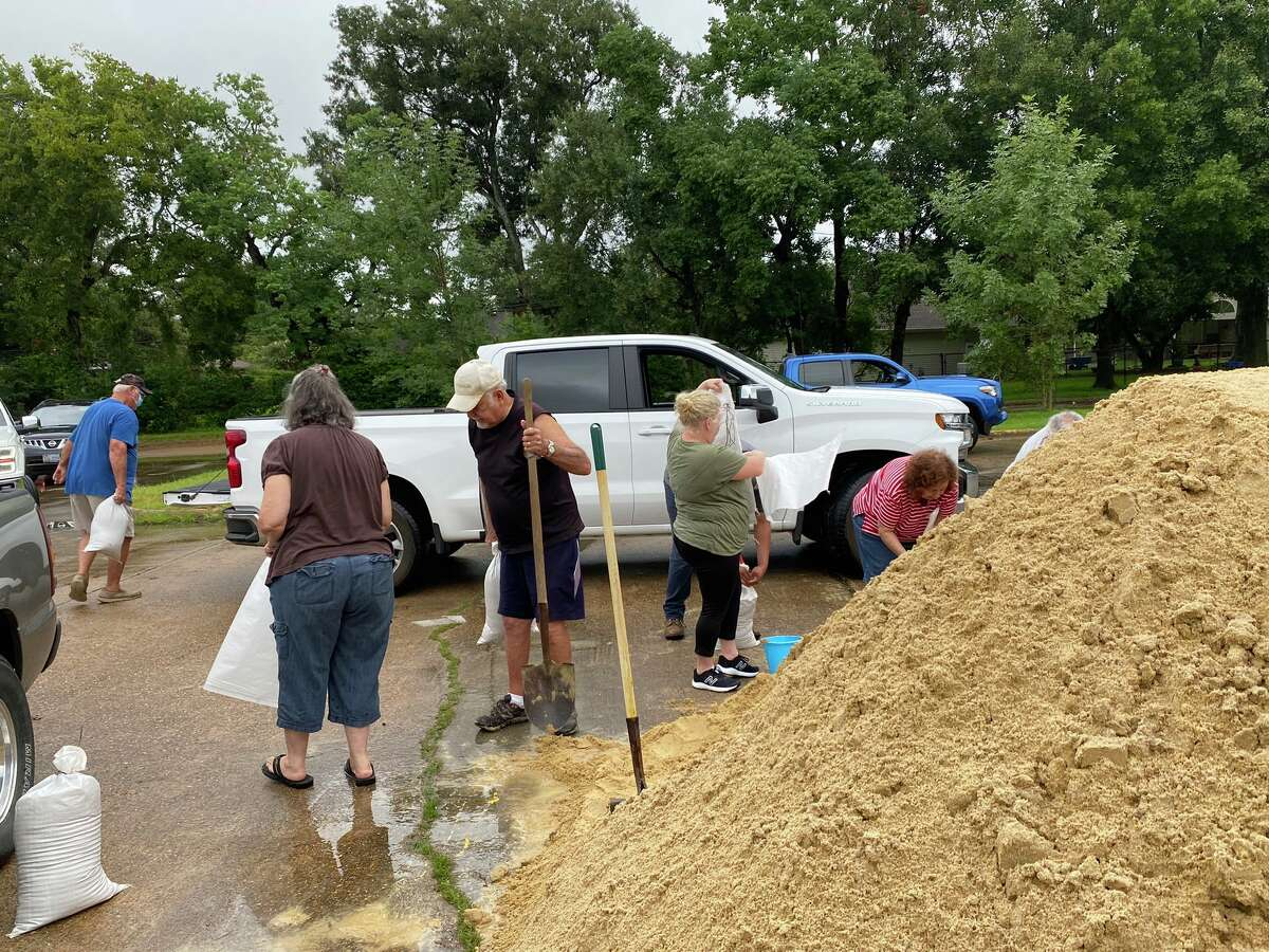 The line for sandbags at Doornbos Park in Nederland already was nearing the main road by the time loading started at 10 a.m.