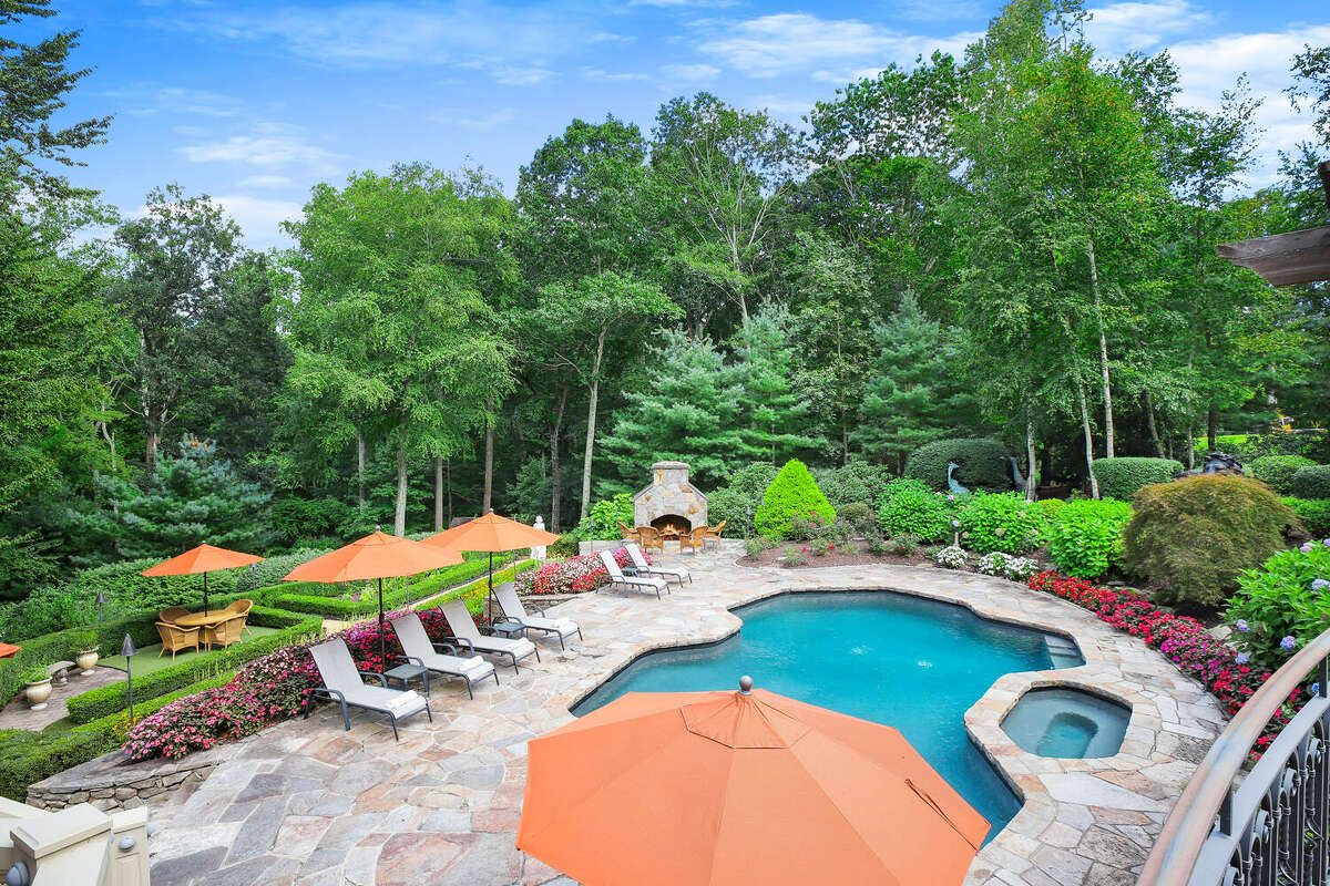The home on 30 Crossbow Lane in Easton, Conn. has a pool, spa and outdoor fireplace.