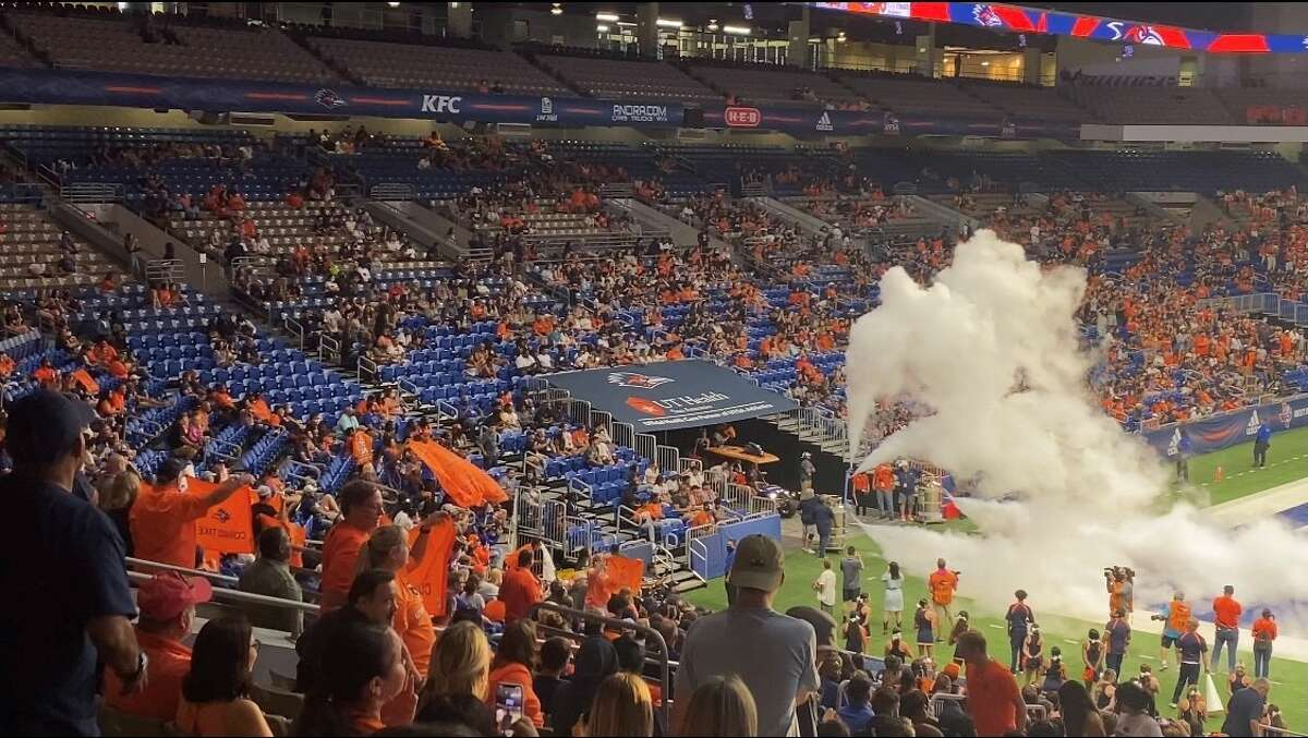 """University of Texas at San Antonio fans brought their own """"Come and Take It"""" flags to Saturday's game, despite the university's recent announcement that it ended the use of the phrase."""