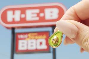 It's an avocado... charm. These are just one of the many pieces you can get at select H-E-B locations.