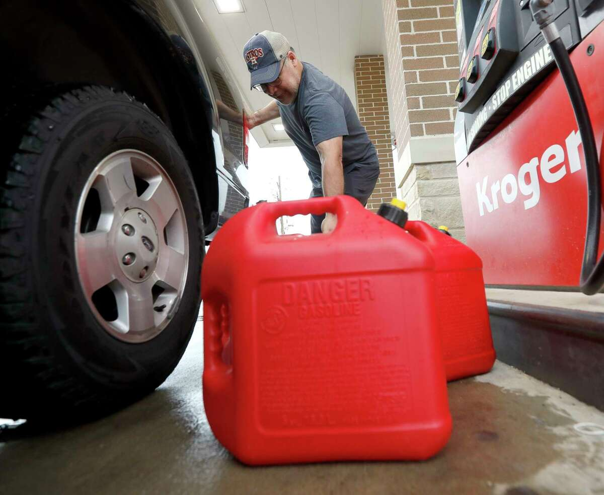 """Paul Villagomez loads filled gas containers into his truck as he prepares for Tropical Storm Nicholas, Monday, Sept. 13, 2021, in Kingwood. """"I'm just trying to be prepared,"""" Villagomez said. """"I'm actually surprised there aren't more people filling up."""""""