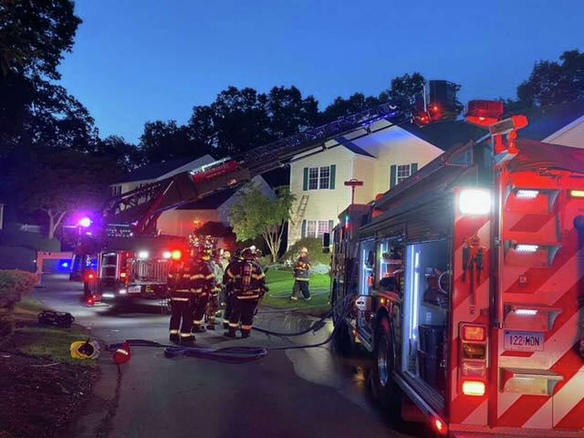 Fire companies were dispatched to an Old Colony Road home in the Great Oak Farm complex in Monroe, Conn., around 5:30 a.m. Friday, Sept. 10, 2021, for a fire in a laundry room that was spreading throughout the house, officials said.