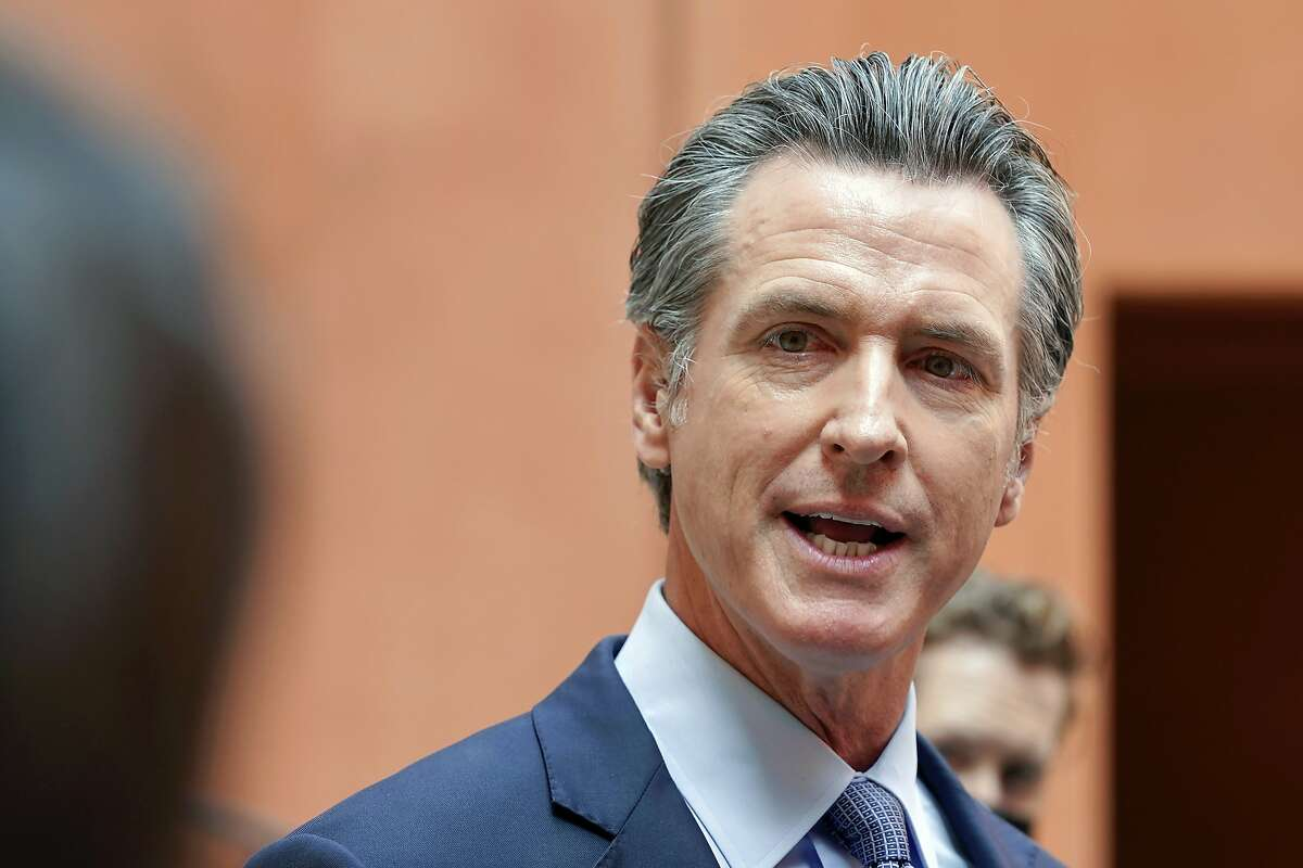 """FILE - In this Sept. 10, 2021, file photo California Gov. Gavin Newsom responds to a question while meeting with reporters after casting his recall ballot at a voting center in Sacramento, Calif. The last day to vote in the recall election is Tuesday Sept. 14. A majority of voters must mark """"no"""" on the recall to keep Newsom in office. (AP Photo/Rich Pedroncelli, File)"""