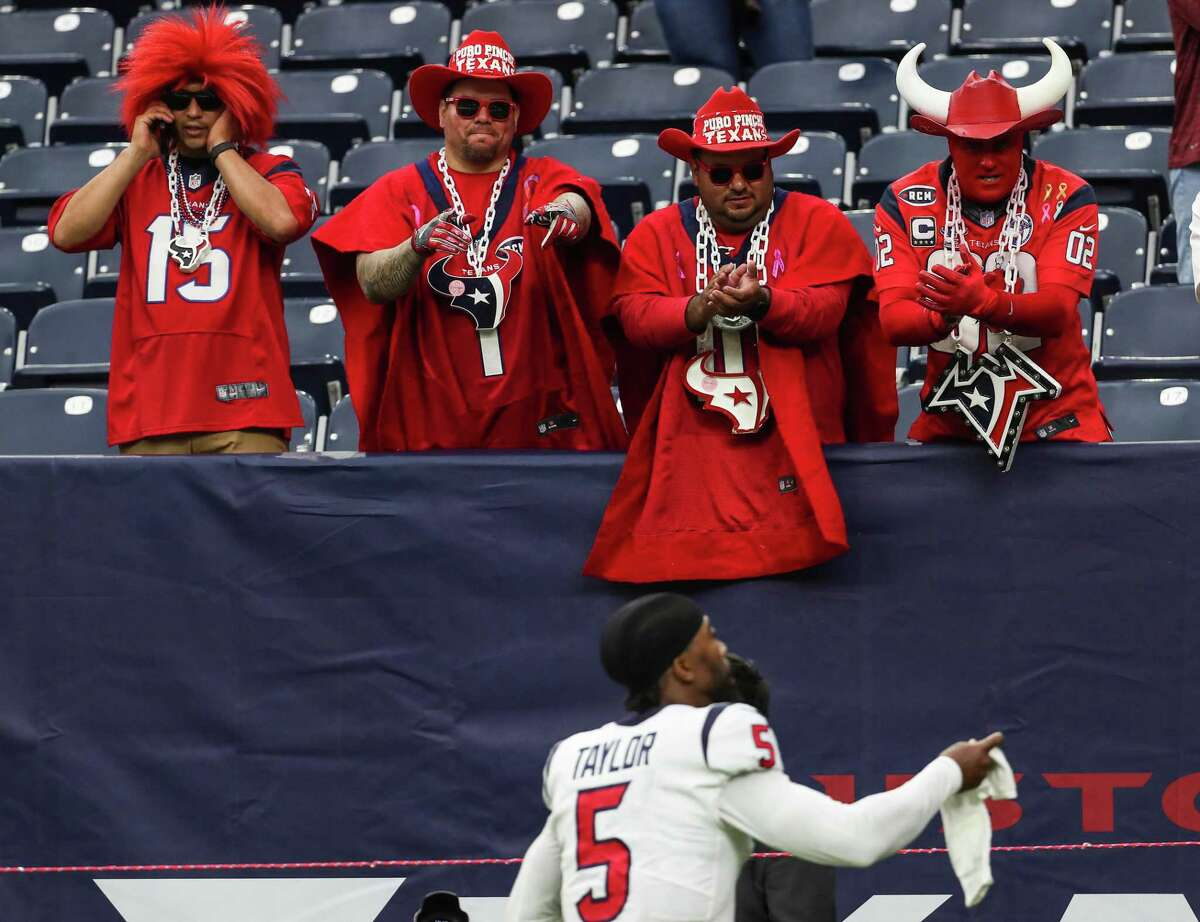 Houston Texans fans cheer as Houston Texans quarterback Tyrod Taylor runs off the field after the Texans 37-21 win over the Jacksonville Jaguars.
