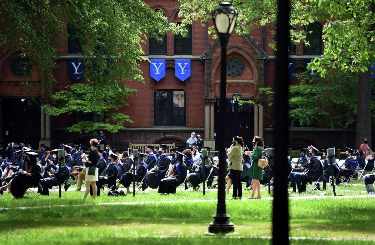 Yale School of Management graduates attend commencement exercises on Yale University's Old Campus in New Haven on May 24, 2021.