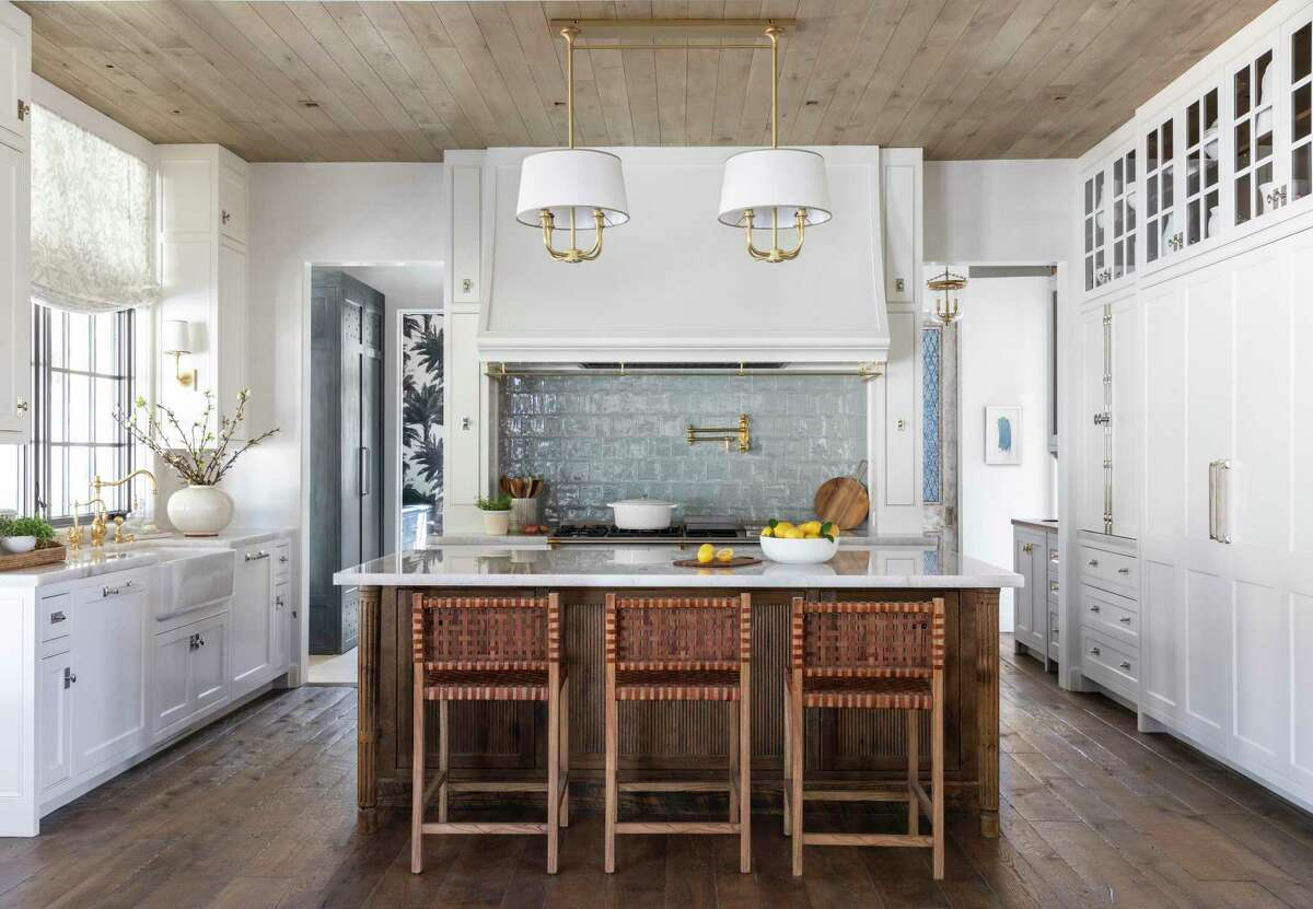 Both functional and pretty, this kitchen gives the Rices places to put everything, and style in every element, from the beautiful Lacanche range to quartzite counters.