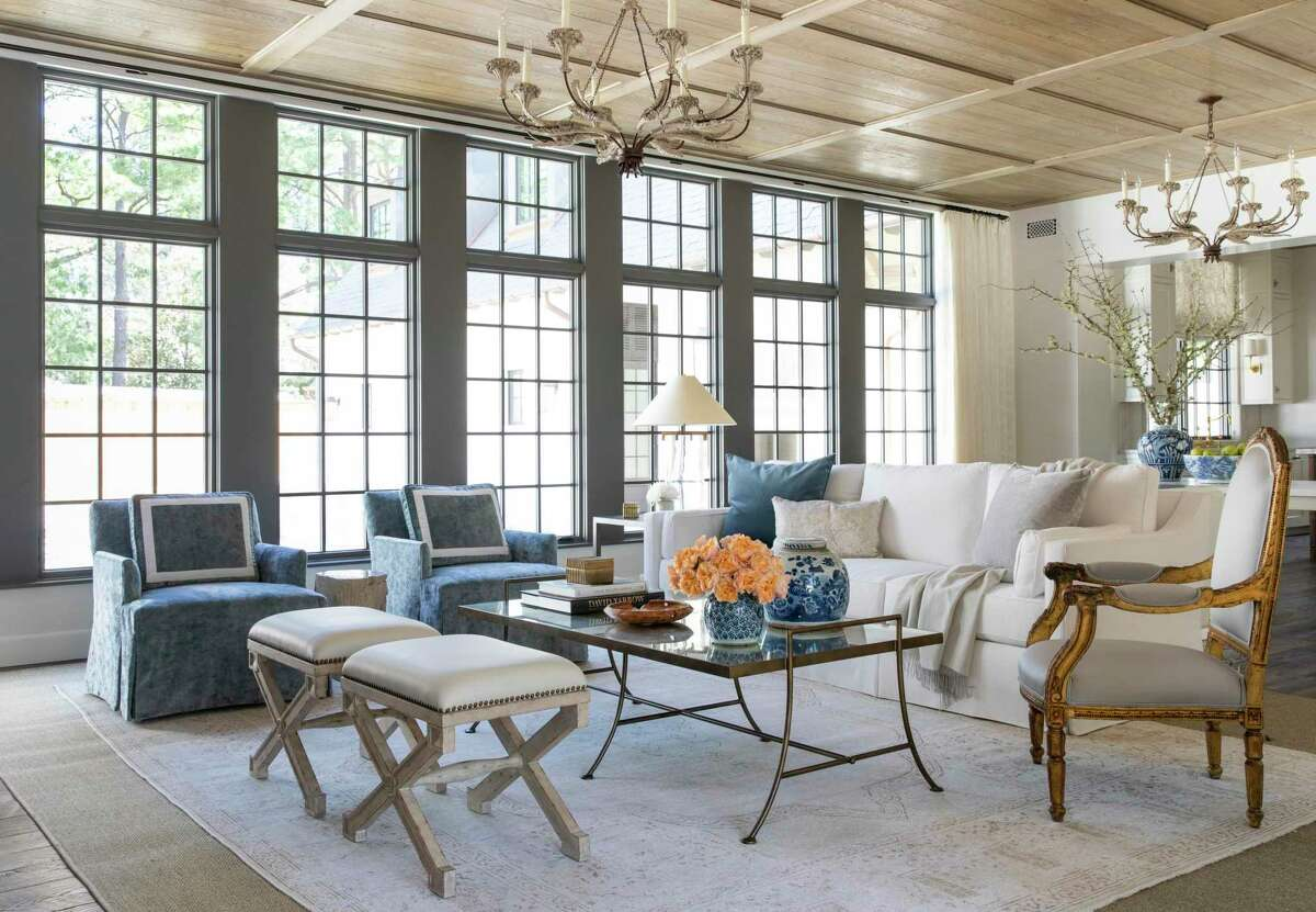 A mix of textures - linen, velvet and sateen, fill the living room.