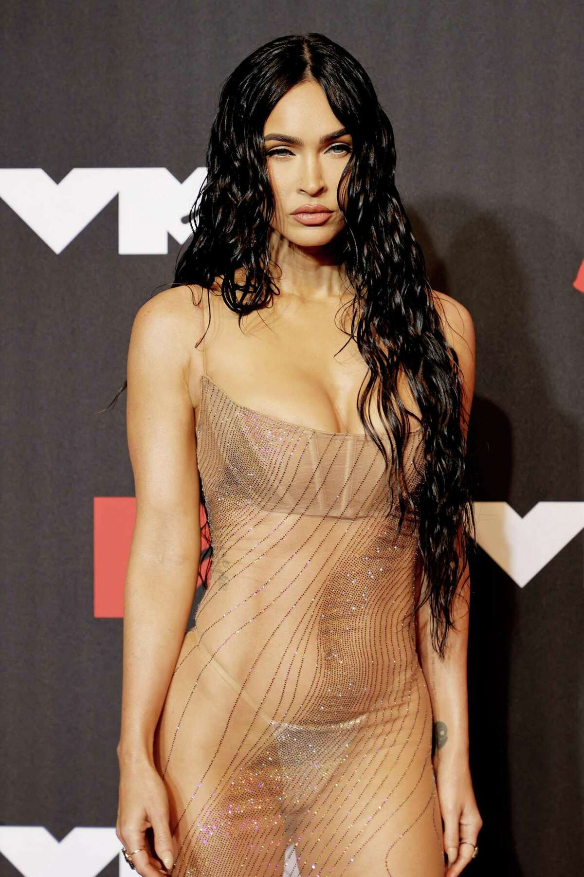 Megan Fox's naked dress attracted attention at the VMAs Sunday.
