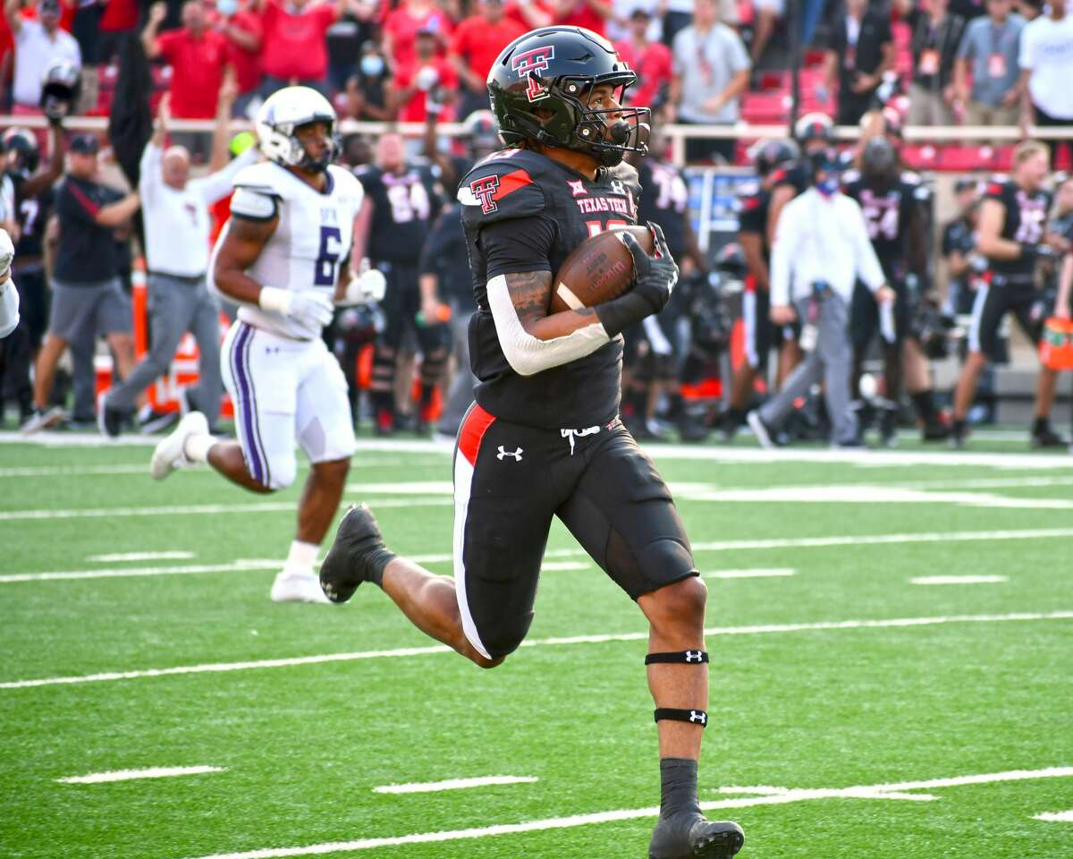Texas Tech receiver Erik Ezukanma breaks off a 75-yard touchdown in the Red Raiders' 28-22 non-conference victory over Stephen F. Austin on Saturday in Jones AT&T Stadium at Lubbock.