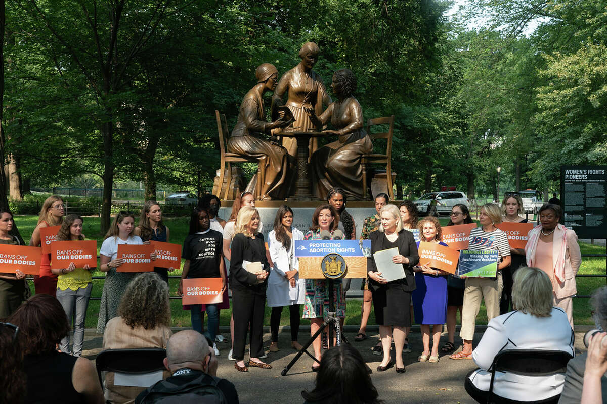Gov. Kathy Hochul surrounded by state politicians at a press conference in Central Park Monday, including U.S. Senator Kirsten Gillibrand and Congresswoman Carolyn Maloney that affirmed abortion rights statewide. (Photo courtesy Office of the Governor)