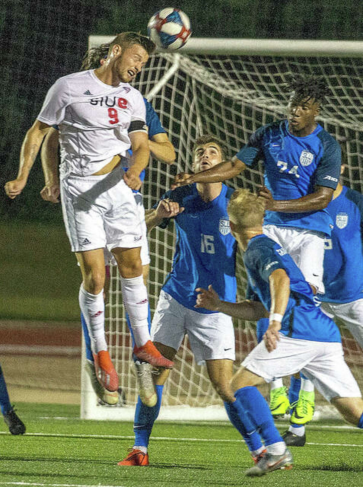 Lachlan McLean of SIUE (9) heads the ball against Saint Louis University in the 2019 Bronze Boot Game at Korte Stadium. Saint Louis U. won in double overtime, 2-1. This year's Bronze Boot game is set for 7 p.m. Tuesday at Saint Louis University.