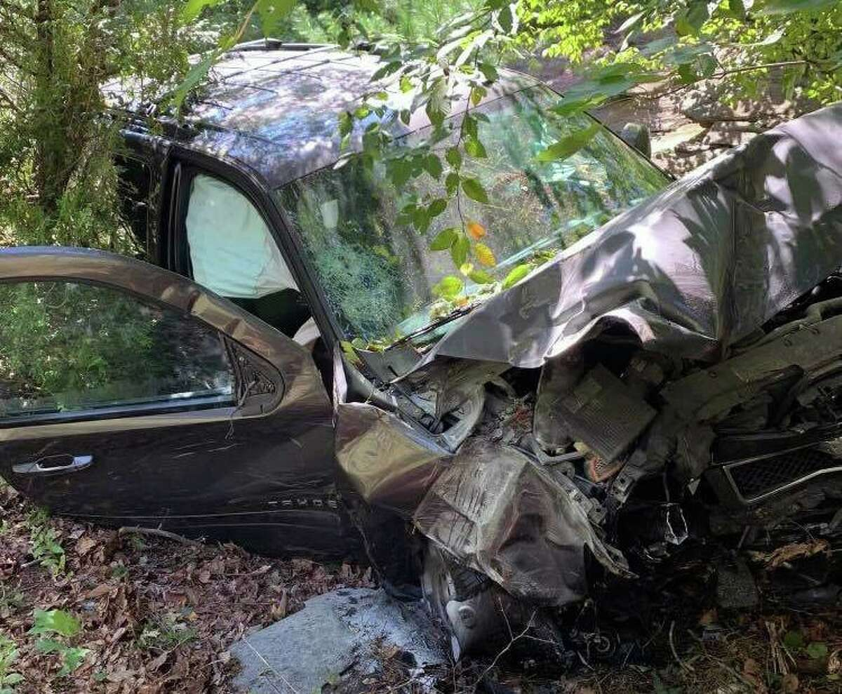 Fire units found a vehicle off Route 8 north near Exit 12 and into the woods in Shelton, Conn., on Friday, Sept. 10, 2021.