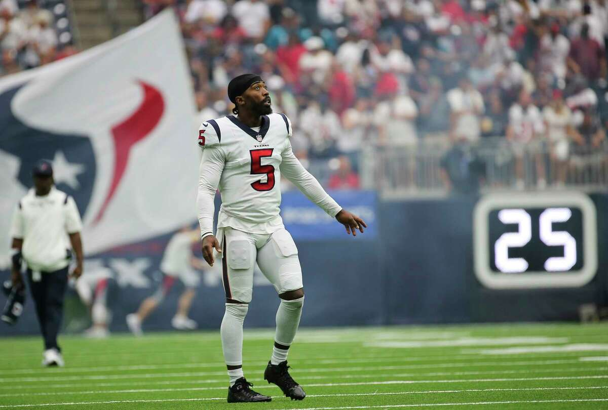 Houston Texans quarterback Tyrod Taylor (5) waits on the sideline to high-five teammates during the first half of an NFL football game against the Jacksonville Jaguars Sunday, Sept. 12, 2021, in Houston.