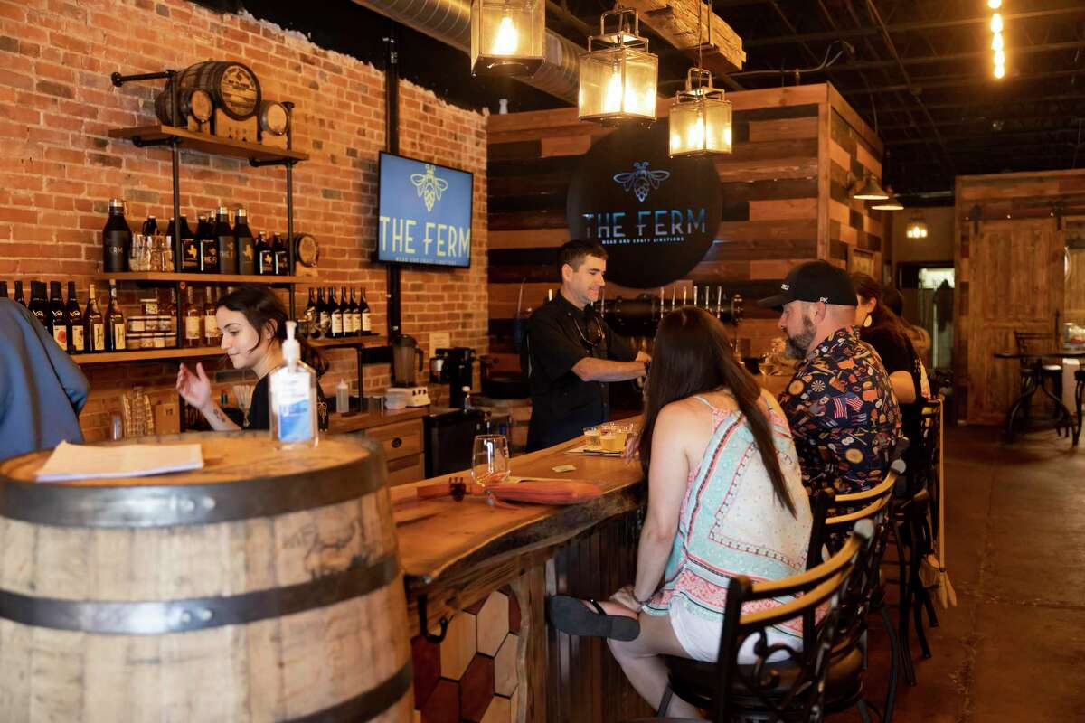 Guests try out various wine at The Ferm during the inaugural Bear Crawl, Saturday, May 29, 2021, in downtown Conroe. The Ferm will also participated in Bridgewood Farm's Sunday Funday from 2 to 5 p.m. this Sunday.