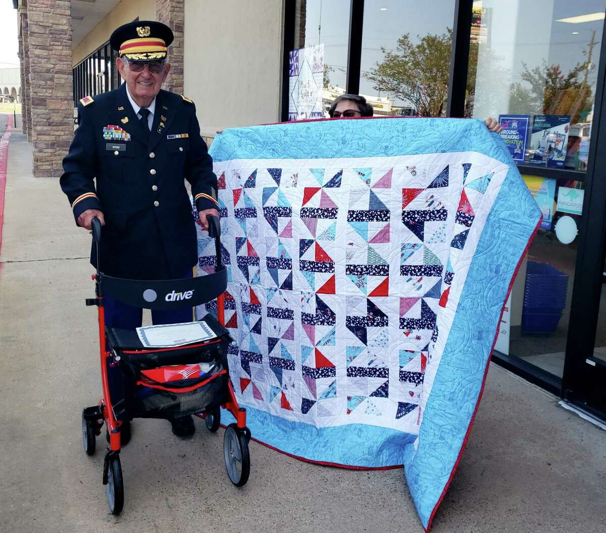 Veteran Calvin Myers was one of 11 veterans to receive a quilt from the Quilts of Valor project. The group presented quilts on Saturday in honor of the 20th anniversary of the 9/11 attacks. The quilts were presented at the Sewing and Vacuum Warehouse in Conroe.