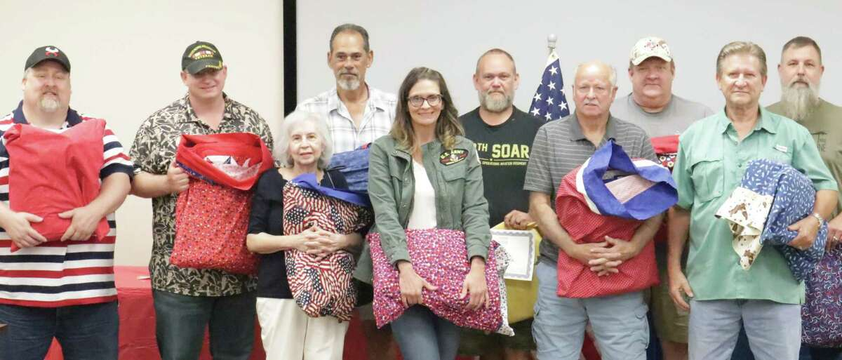 Conroe-area veterans were presented handmade quilts from the Quilts of Valor project on Saturday at the Sewing and Vacuum Warehouse in Conroe. The donation of quilts marked the 20th anniversary of 9/11 and paid tribute to local veterans.