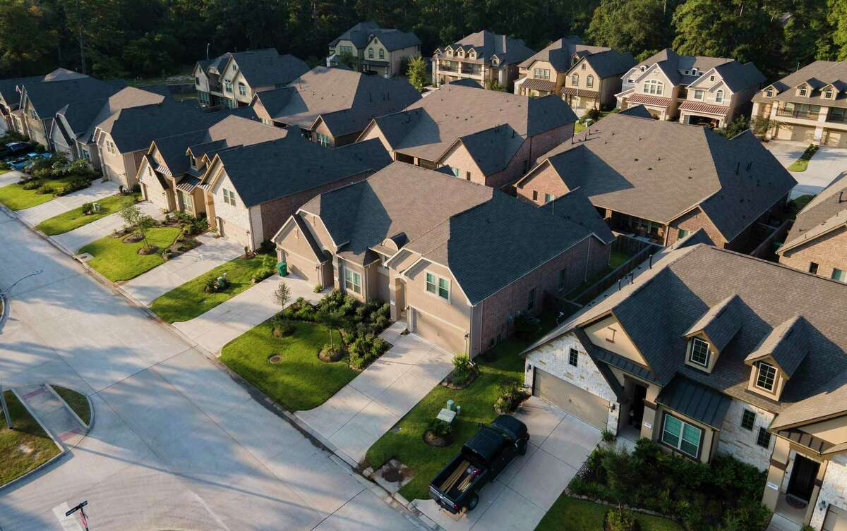 Townhomes in Grand Central Park are seen Friday, Sept. 10, 2021, in Conroe. Priced from the high $200s, Gehan's new Grand Central Park 1,700-2,200 square-foot townhomes feature three-and four-bedroom plans with choice of first-floor or second-floor Owner's Suite with walk-in closet, washer-dryer area and other builder options.