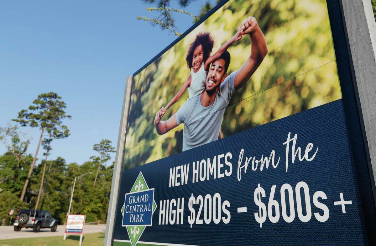 A sign promotes homes in Grand Central Park ranging from the high $200,000 to more than $600,000, Friday, Sept. 10, 2021, in Conroe.
