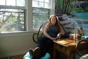 Lindsay Fitzpatrick sits in the sunroom at the home she rents with other people on Monday, Sept. 13, 2021, in Albany, N.Y.
