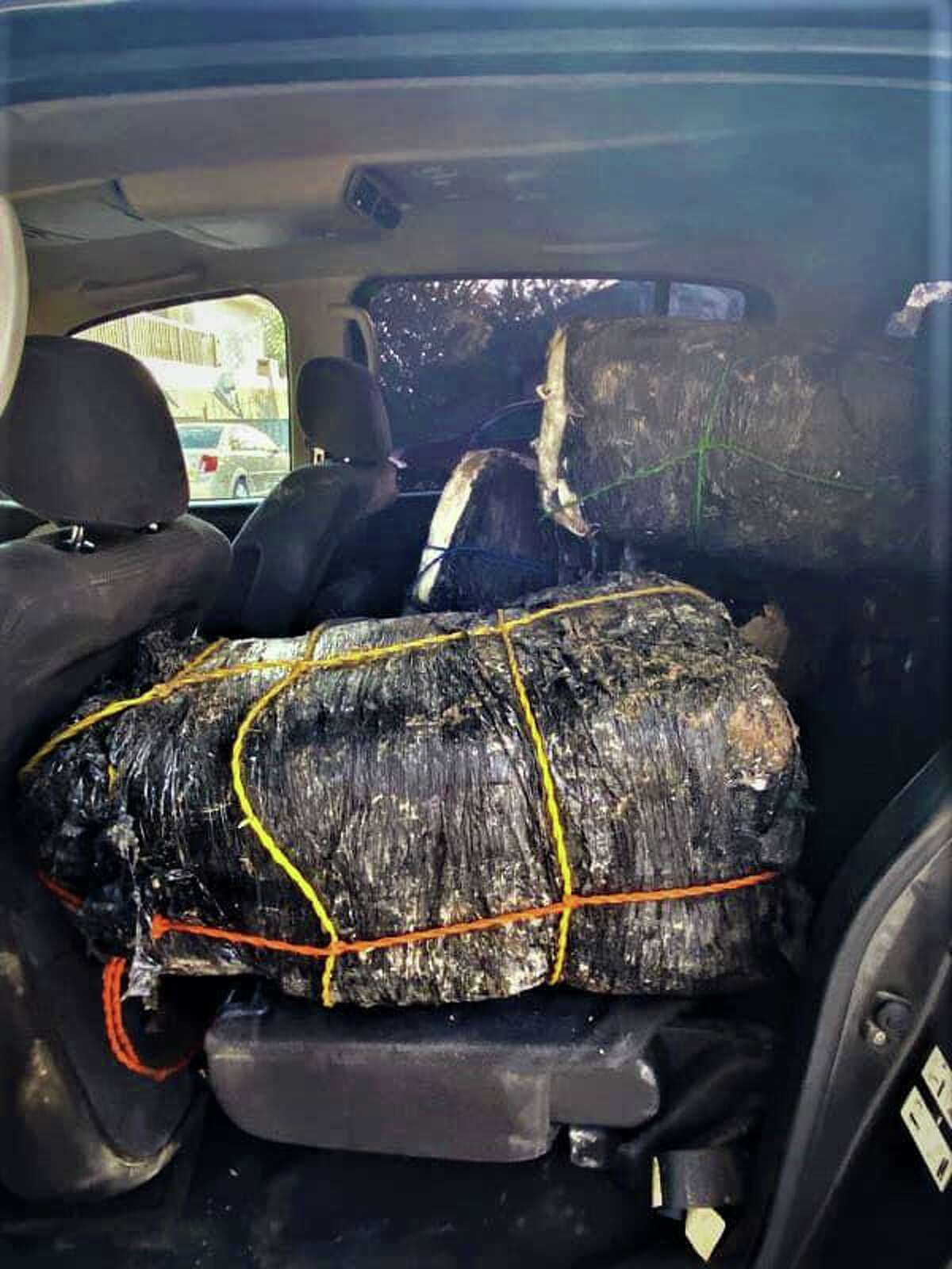 U.S. Border Patrol said this vehicle loaded with approximately $381,000 in marijuana was abandoned in the parking lot of Father McNaboe Park. The contraband weighed 477.3 pounds.