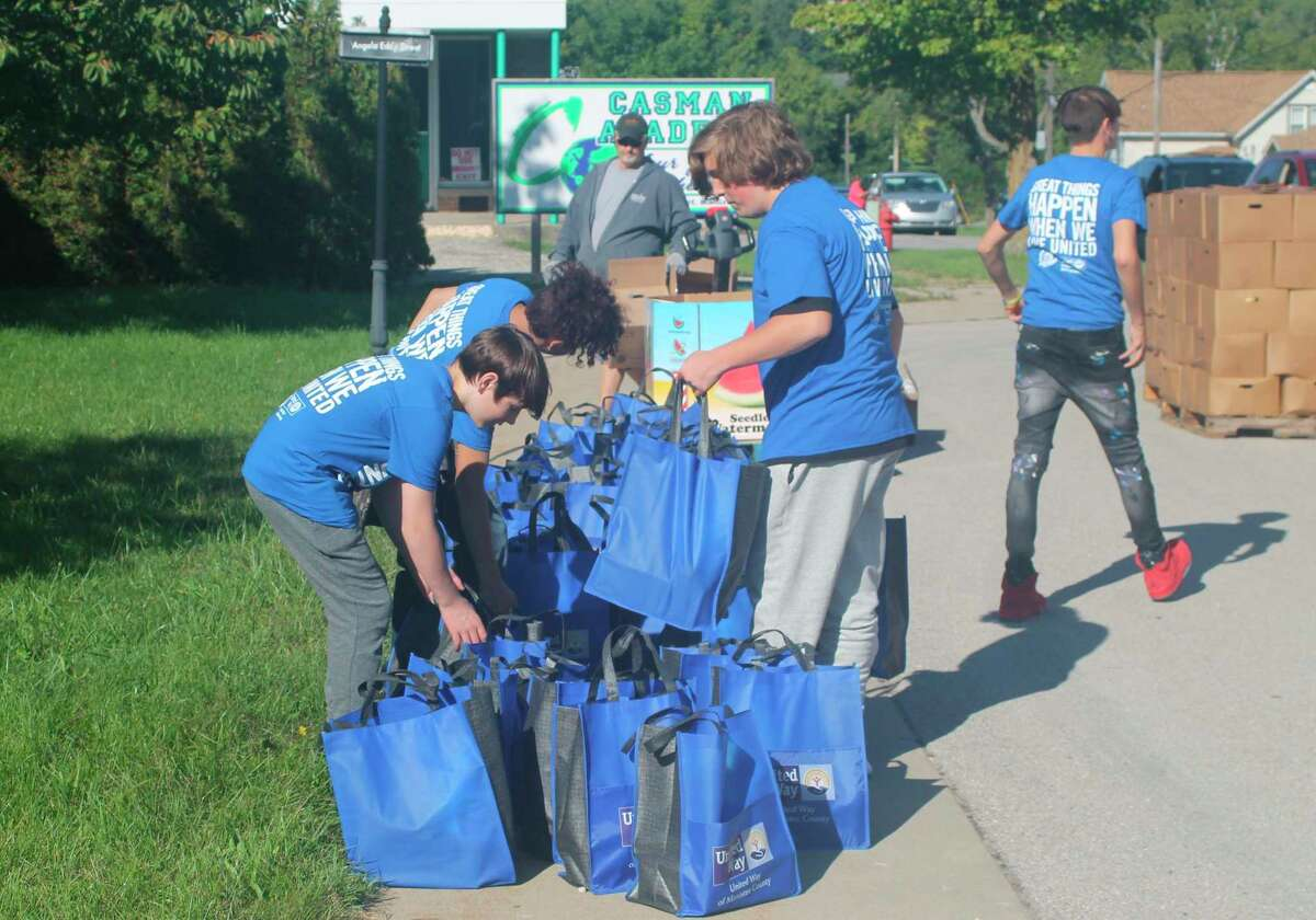 CASMAN Academy students prepare bags of food for the Feeding America mobile food pantry at the school on Friday. In total, 444 individuals in 162 households received 11,767 pounds of food as a result of the food truck. (Kyle Kotecki/News Advocate)