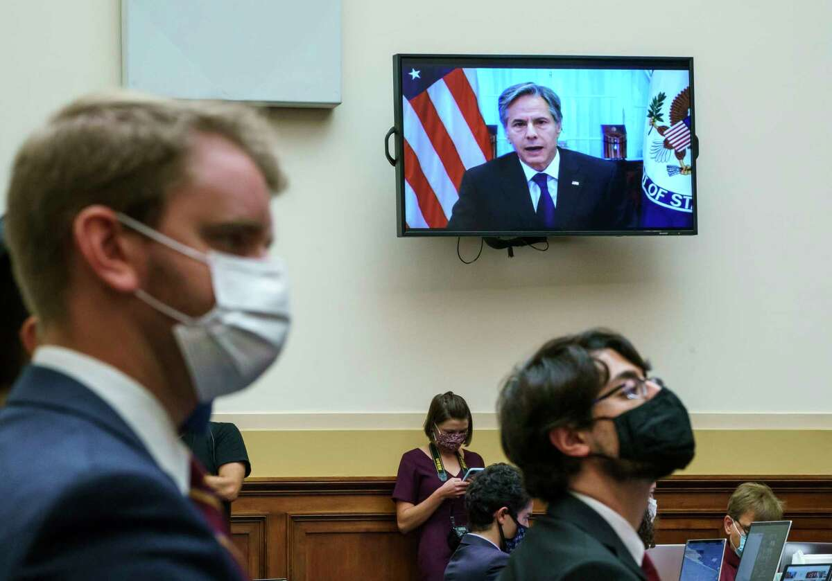 Secretary of State Antony Blinken appears remotely on a TV monitor to answer questions from the House Foreign Affairs Committee about the U.S. withdrawal from Afghanistan, at the Capitol in Washington, Monday, Sept. 13, 2021.