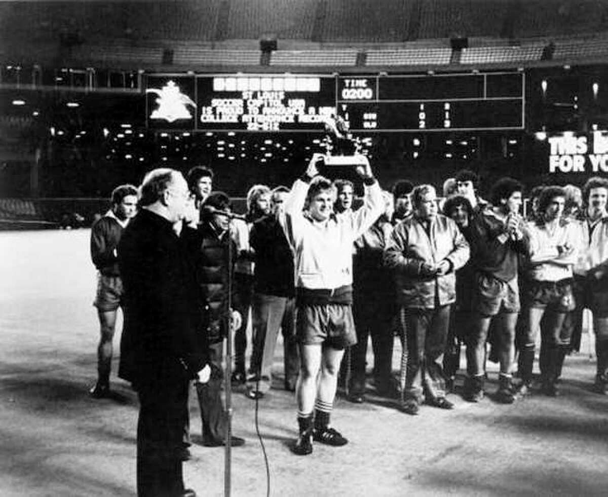 Members of the Saint University men's soccer team celebrate winning the 1980 Bronze Boot game at Busch Memorial Stadium in St. Louis.