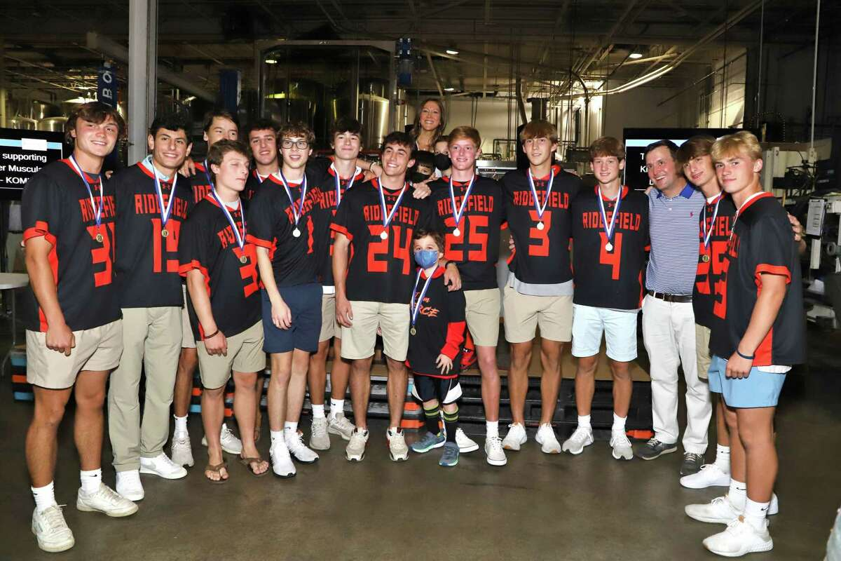 Many players from Ridgefield High School's championship lacrosse team attended the event to support their honorary captain, Conner Curran, center. Curran was diagnosed with Duchenne muscular dystrophy when he was 5.