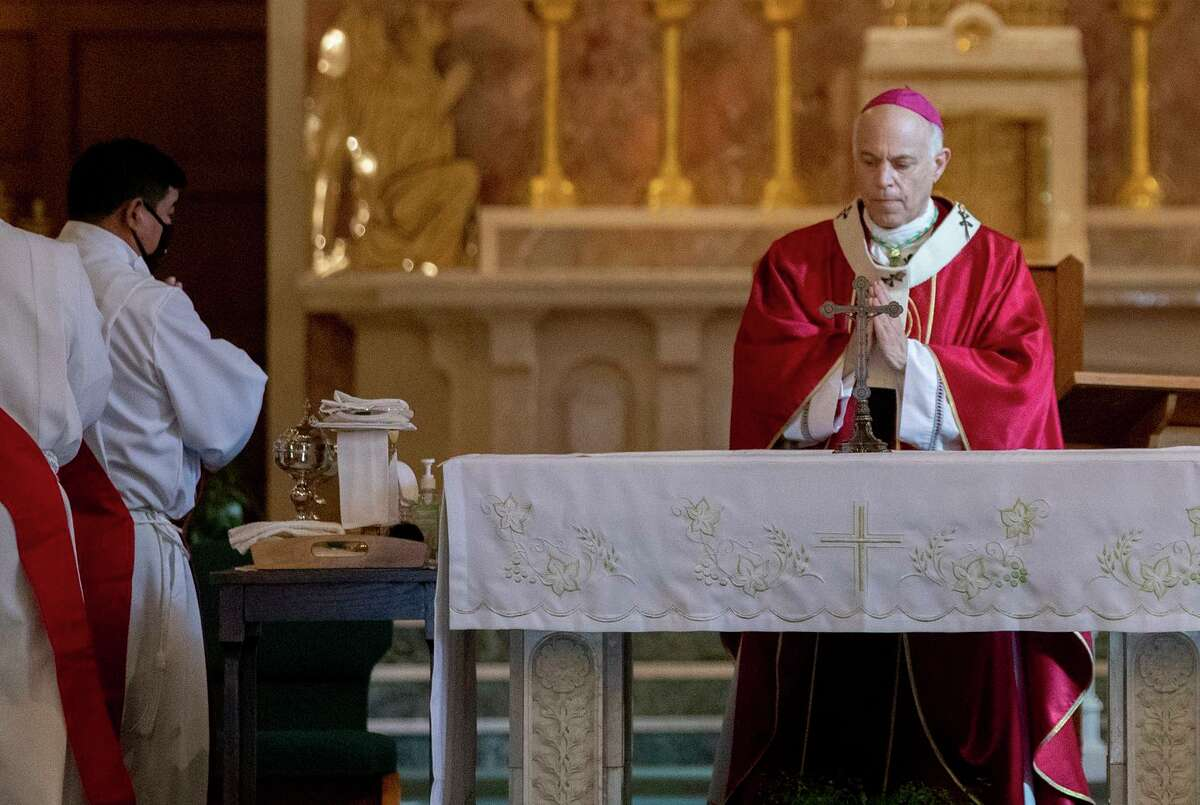 San Francisco's Archbishop Salvatore Joseph Cordileone holds Mass services in San Rafael last year. Cordileone appealed to Gov. Gavin Newsom to stop a bill that allows a statue of Father Junipero Serra to be permanently removed from the state Capitol grounds in Sacramento.