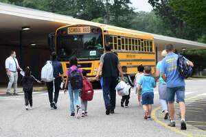 Students enter the first day of school at Newfield Elementary School in Stamford, Conn. Monday, Aug. 30, 2021.