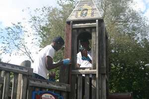 FSU mens' and women's basketball players helped restain the playground equipment at Hemlock Park this past Friday.