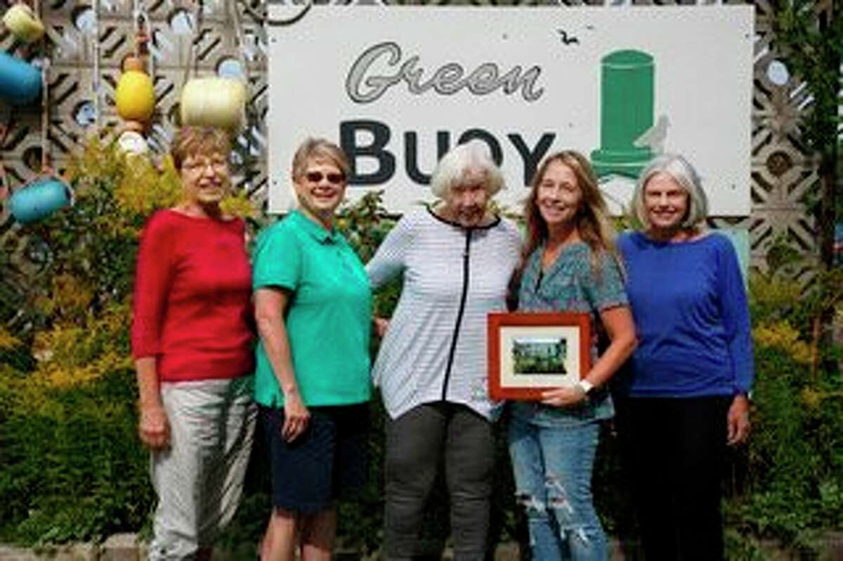 Members of the Portage Lake Garden Club present the Civic Beautification Award to Wendy Kamaloski of the Green Buoy Resort. Pictured (left to right) areFaye Backie, Mary Jo McElroy, Alice Mesaros, Wendy Kamaloski and Bonnie Garbrecht. (Courtesy photo/Elaine Maylen)