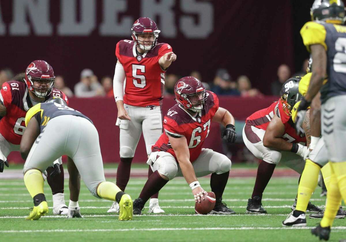 San Antonio quarterback Logan Woodside directs the offensive line as the Commanders host San Diego at the Alamodome in the opening game for the Alliance of American Football league on Feb. 9, 2019. The league folded after its eighth game. Two AAF players filed a class-action lawsuit against the now-defunct league and its backers for fraud and breach of contract.