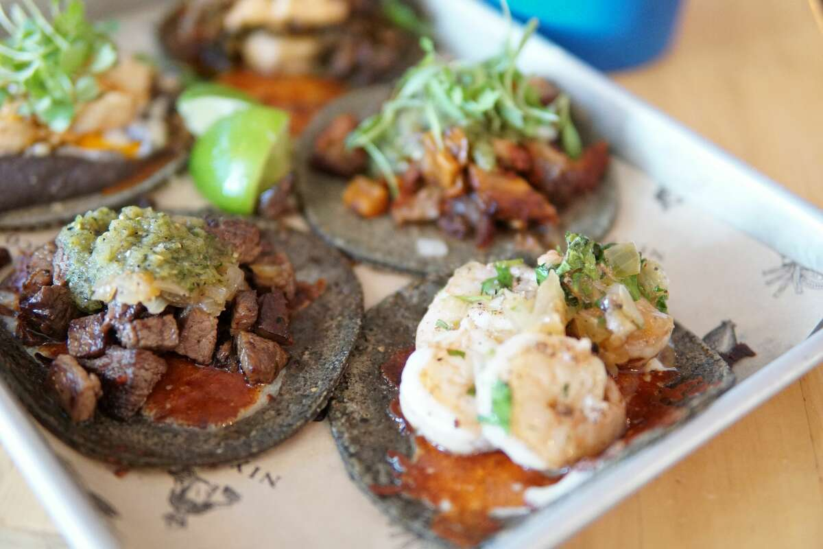 An assortment of tacos from Nixtaco in Roseville, featuring blue corn tortillas.