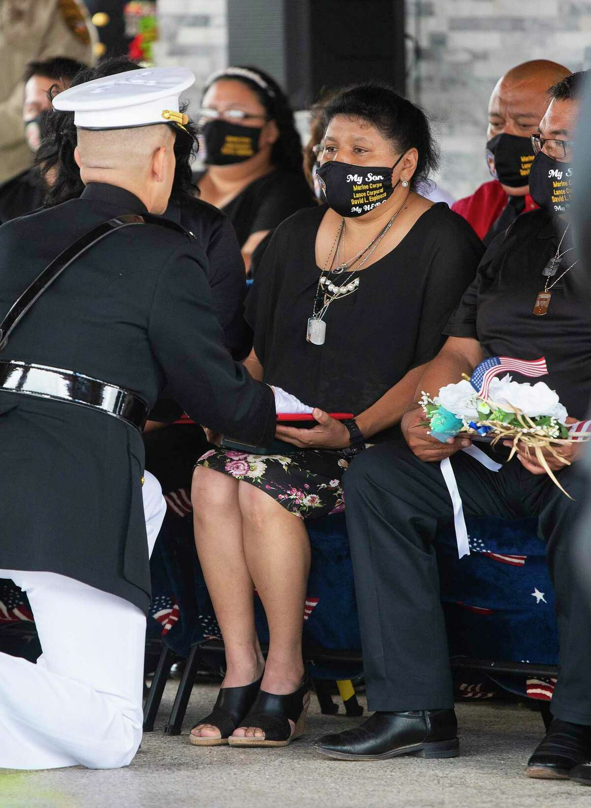 Lance Corporal David Lee Espinoza's mother, Elizabeth Holguin, is presented with Espinoza's Purple Heart, Monday, Sept. 13, 2021 at the City of Laredo Cemetery during a ceremony before Espinoza's burial.
