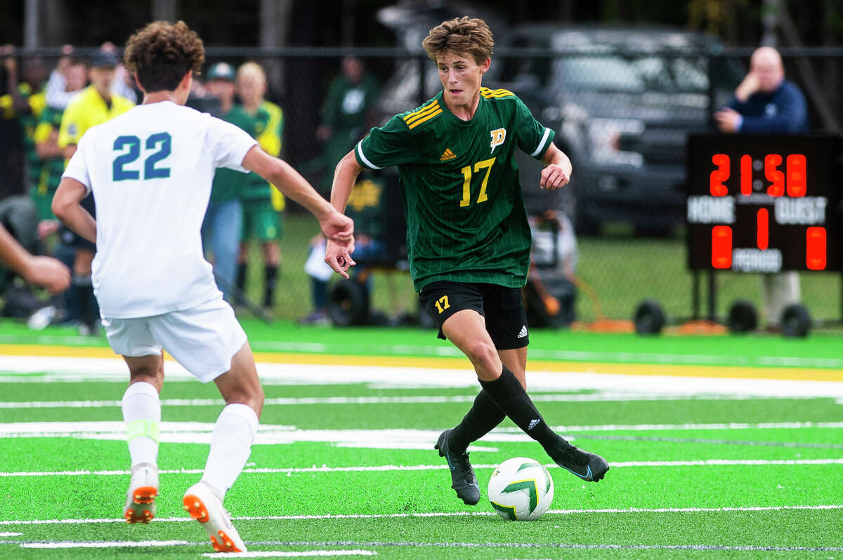 Dow's Isaac Skinner dribbles down the field during the Chargers' game against Lapeer Monday, Sept. 13, 2021 at H. H. Dow High School. (Katy Kildee/kkildee@mdn.net)