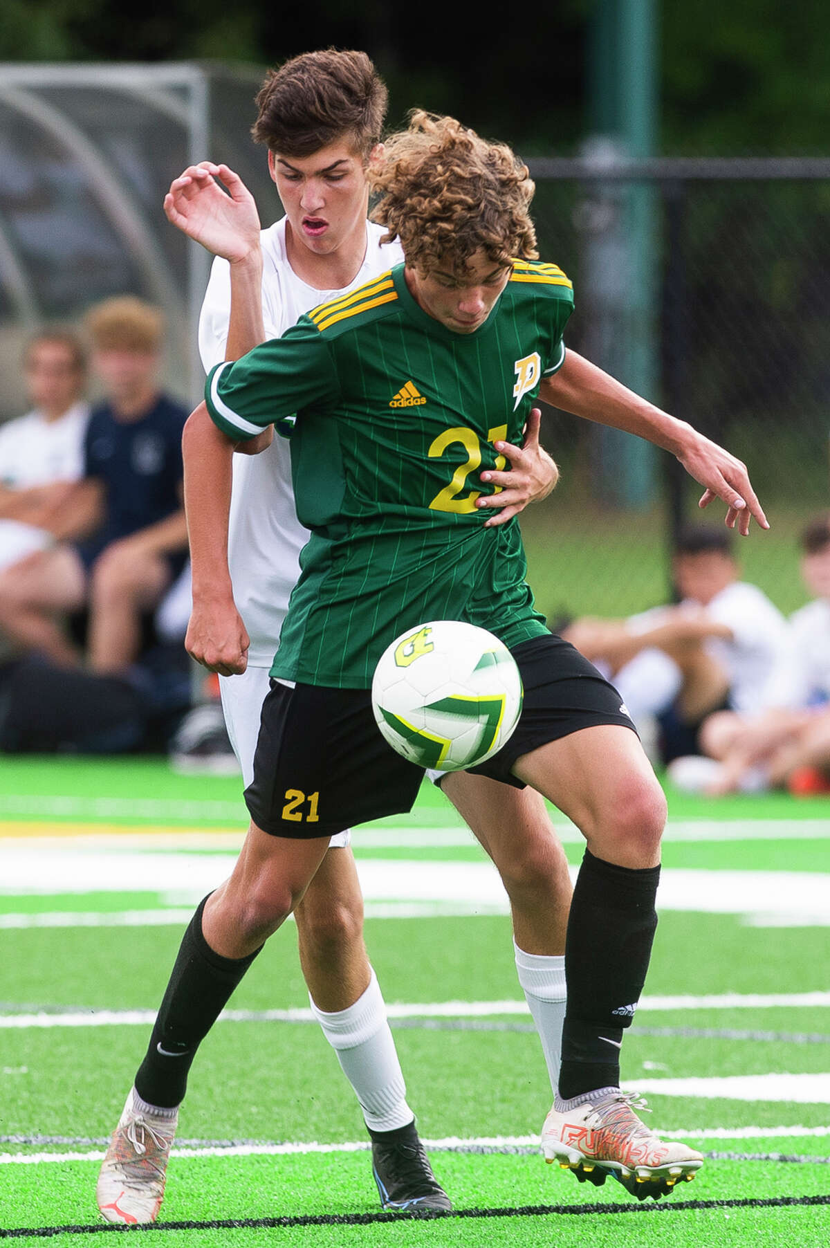 Dow's Chase Horneber dribbles down the field with pressure from an opponent during the Chargers' game against Lapeer Monday, Sept. 13, 2021 at H. H. Dow High School. (Katy Kildee/kkildee@mdn.net)