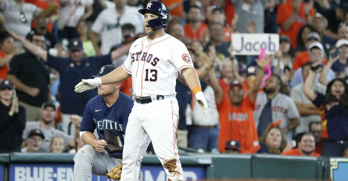 Houston Astros Jacob Wilson (13) stands on third base after hitting a triple off Seattle Mariners starting pitcher Logan Gilbert during the third inning of an MLB baseball game at Minute Maid Park, Saturday, August 21, 2021, in Houston.
