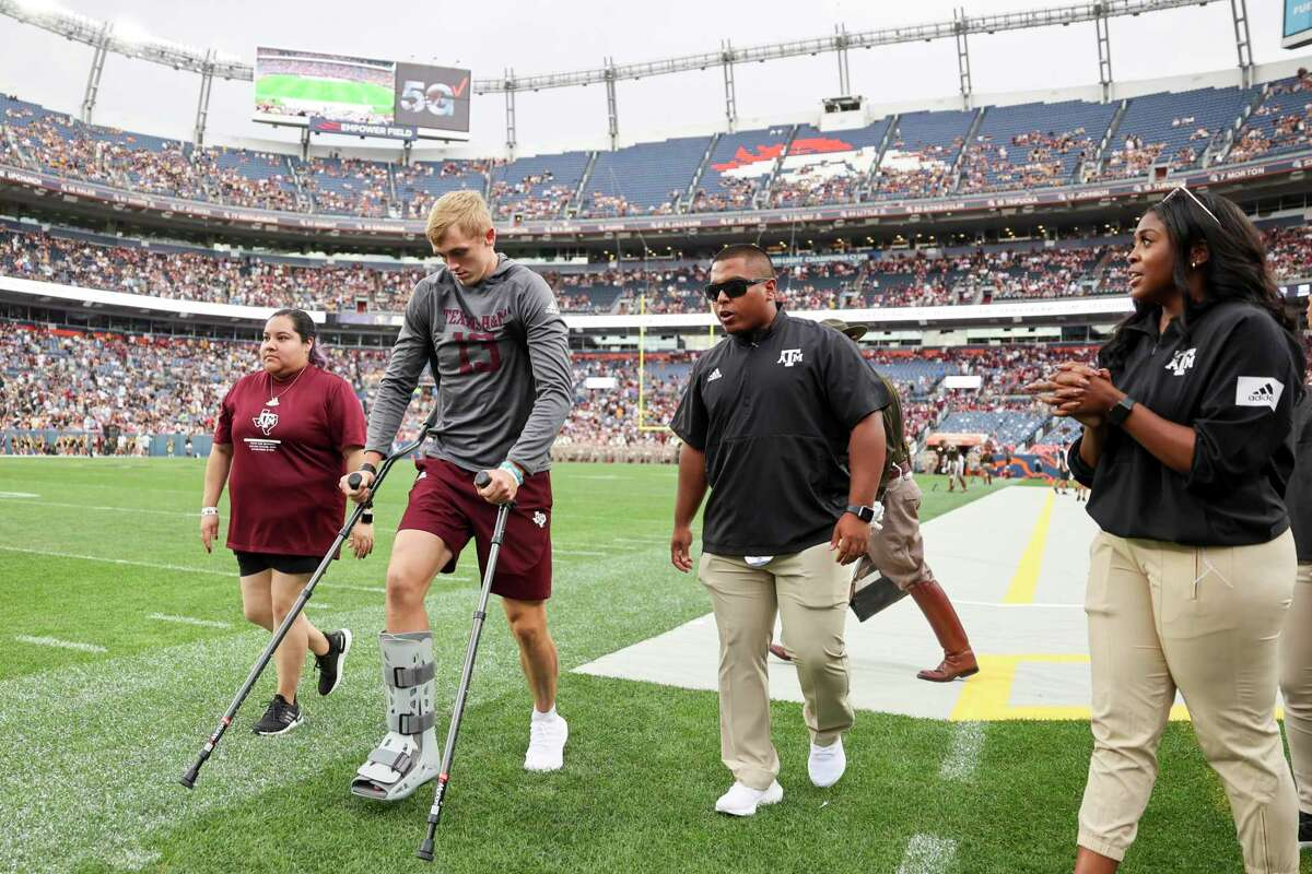 """Aggies QB Haynes King uses crutches to leave the field for halftime Saturday against Colorado. A&M coach Jimbo Fisher said surgery on King's fractured tibia went """"clean as a whistle."""""""